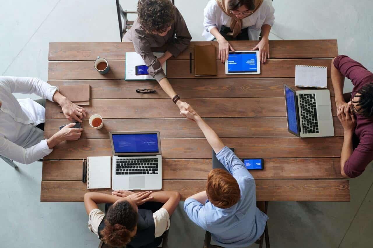 people-sitting-around-boardroom-table
